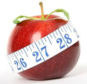 apple with body measuring tape