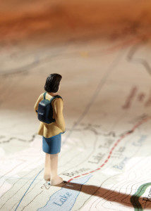 woman hiker standing on topo map with directions