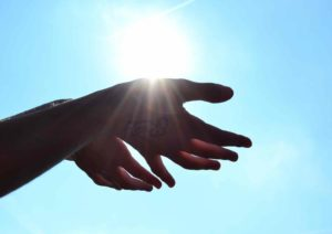 womans hands holding the sun
